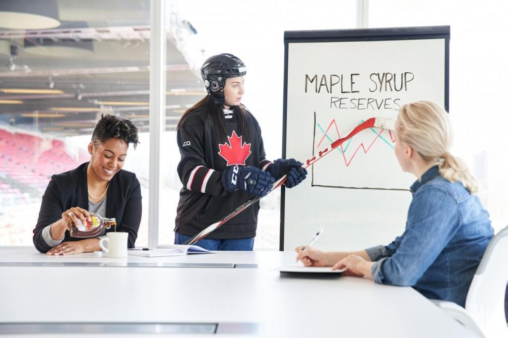 Colleague enjoys tasty glass of maple syrup